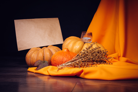 composition for Halloween, lie yellow and orange pumpkins, candles are burning Stock Photo