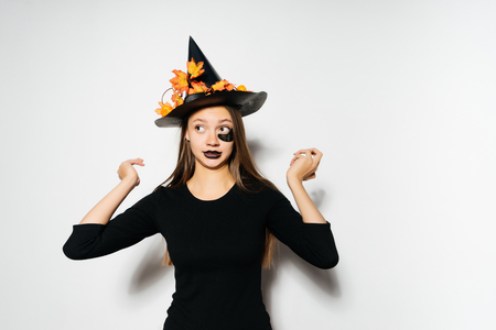 young gothic sexy girl in the shape of a witch in halloween, Stock Photo