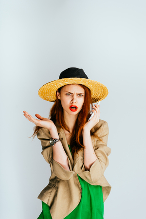 désolé: sorry girl in a hat talking on the phone