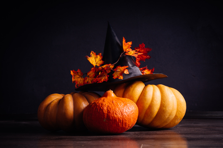 a composition for decorating a house for halloween, orange pumpkins, a big black witch hat Stock Photo