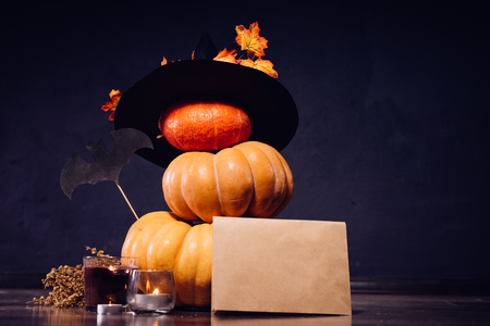 several pumpkins decorated with a witch hat for halloween Stock Photo