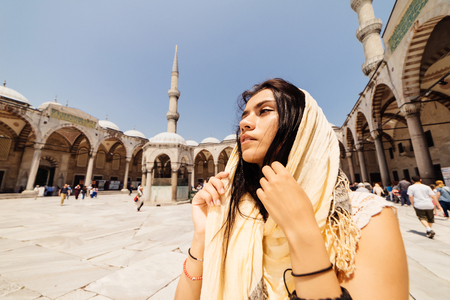 A young Muslim woman in a scarf goes to the mosque, Istanbul. Summer vacation, travel. Hispanic girl, Iranian, Syrian woman Stock Photo