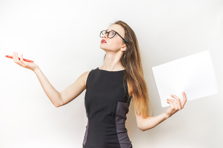 a stylish modern girl with glasses and a black dress is holding a sheet of paper in her hands, thinking about something