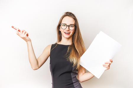 stylish successful young girl with glasses, office worker, holds documents in her hands and looks happy