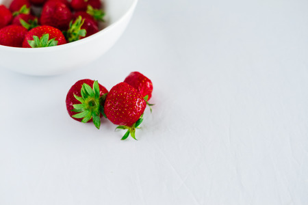 Fresh raw healthy diet strawberries fruit in plate,isolated on white,view above,flatlay close-up,copyspace for text,frame