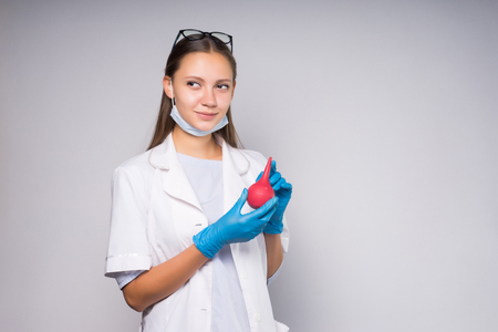 Young girl nurse holds a syringe in hands Stock Photo