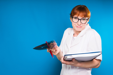 Woman doctor with a surprised gesture on a blue background