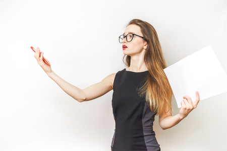 Woman repetition speech,in a black dress and glasses Stock Photo