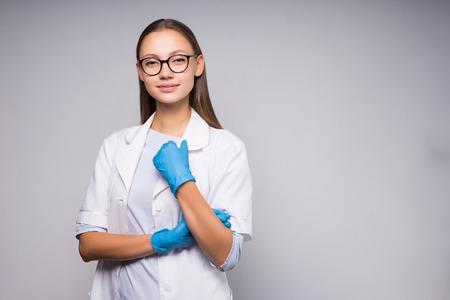 Girl nurse in glasses posing against white background Stock Photo