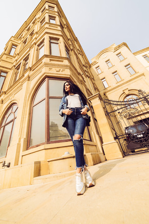 stylish attractive girl in jeans arrived on vacation in Baku, Azerbaijan, likes to travel