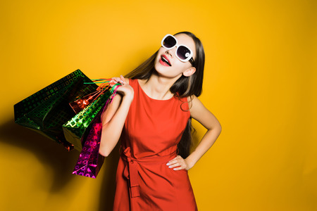 happy young girl in sunglasses happy black Friday and shopping Stok Fotoğraf - 90772286