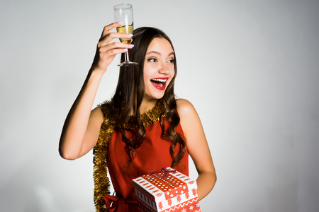 happy beautiful girl celebrates the new year 2018, holds in her hand a glass of champagne and a gift Stock Photo