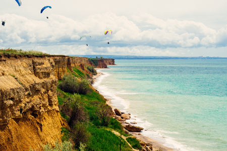 inspiring nature, calm blue sea, airplanes fly in the sky Stock Photo