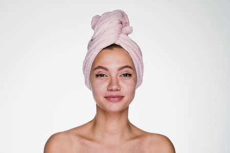 young girl with a towel on her head after a shower