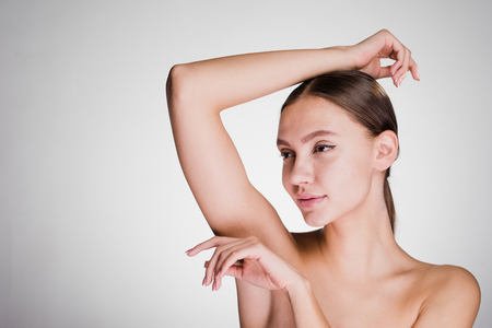 attractive beautiful young girl showing her armpits without hair