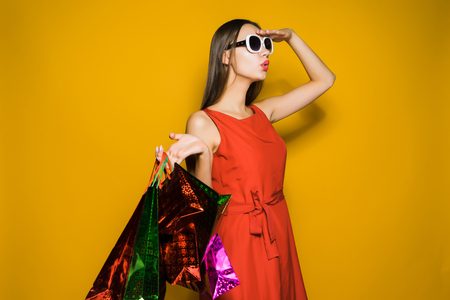 young stylish girl shopaholic in sunglasses looking afar and looking for discounts Stock Photo