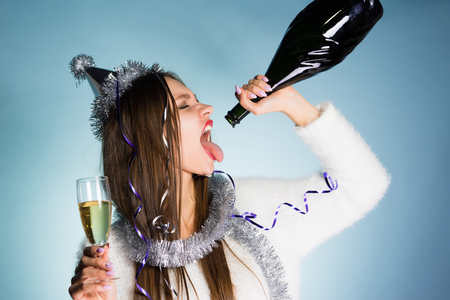 young drunk girl drinks the remains of champagne