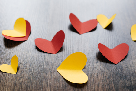 Valentine s Day background, red and yellow hearts on wood texture