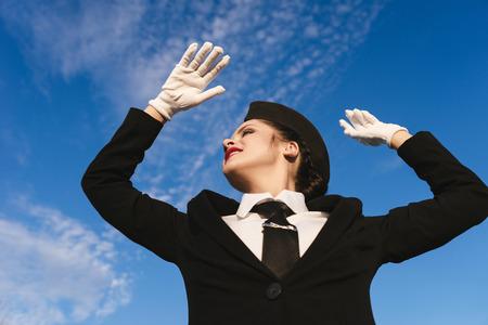 woman in flight attendant uniform on blue sky background