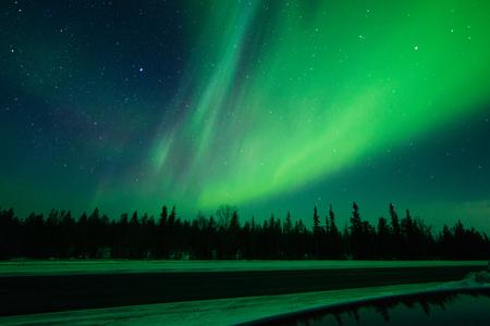 Northern lights , Aurora borealis, green, purple, blue, stars. North Pole, Iceland, Russia
