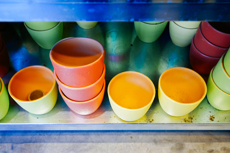 colorful design dishes stand on the shelf