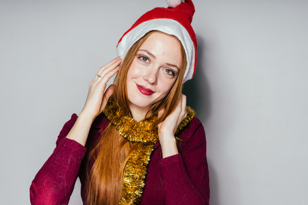 happy woman in a New Years cap on a background of gifts Stock Photo