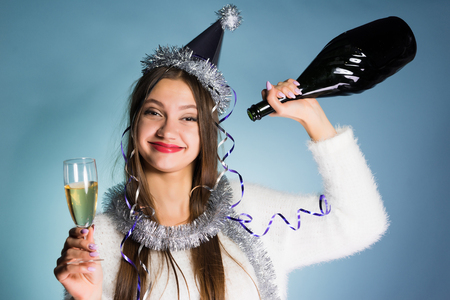 happy young drunk girl celebrating the new year, drank all the champagne