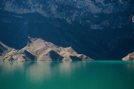 blue beautiful lake on a background of high mountains Stock Photo