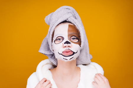 woman after shower applied moisturizing mask and poses on camera