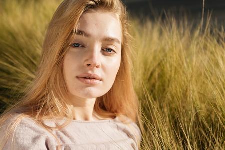 a Russian woman is sitting in the open field