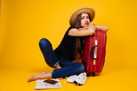 sad woman with a suitcase, independent travel