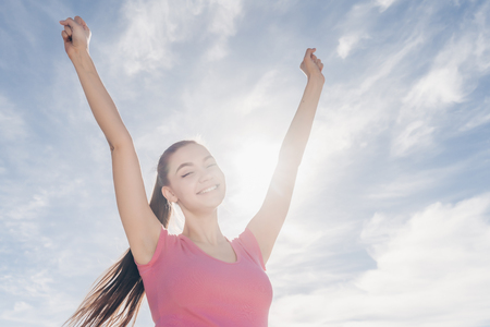 happy young girl enjoys a good workout outdoors, loves sports and a healthy lifestyle Stock Photo