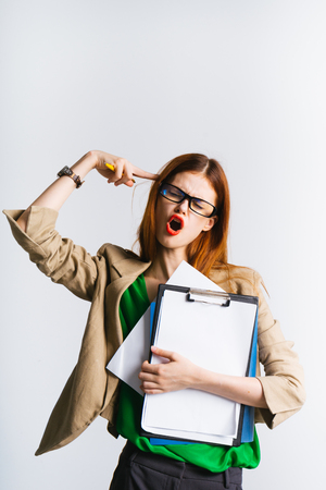 girl secretary with glasses in frustration holding folder