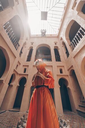 woman in national dress morocco at the temple