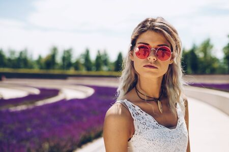 girl in the park on a background of blooming lavender