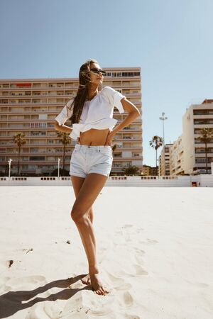 girl stands on the beach sand 写真素材