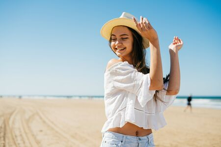girl in wild west style clothes dance on the beach