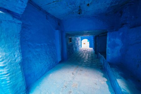 Morocco blue city corridor stretching into the distance and deserted