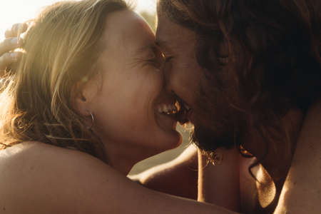 close-up. man and woman laugh and touch each others faces. High quality photo Stock Photo