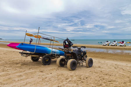 atv on the beach in thailand Stock Photo