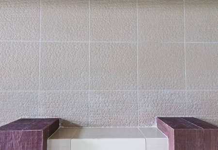 Concrete wall, a table format.Bathroom wall. And squares.