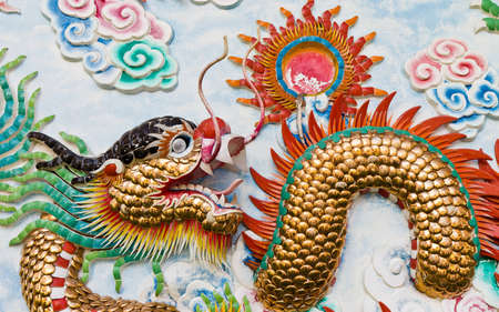 Statue of a dragon on the wall, in a Chinese temple, in the daytime. Stock Photo - 11081125
