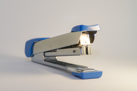 collegue: Silver and blue stapler with white background