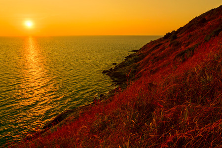 rock coast with grass and sunset at Rayong photo