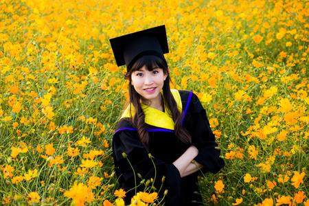 doctoral: Girl Graduate Among Beautiful Flower