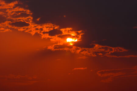 sun drenched: Sunset Behind Cloud
