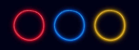 Neon circles set isolated on dark background. Conceptual glowing round shapes for graphic design.