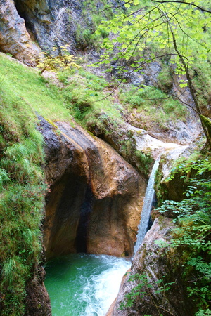 Waterfall with bare rocks in Almbach gorge near Berchtesgaden in Eastern Germany Stock Photo