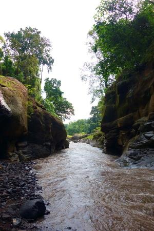 Mangku Sakti Waterfall flowing from Rinjani volcano, Lombok, West Nusa Tenggara, Indonesia, South-East Asia