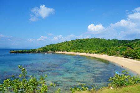 Beautiful landscape of Pantai Nipah, Lombok island scenic travel destination beach with crystal blue waters and coconut trees - near Bali, Indonesia, South-East Asia
